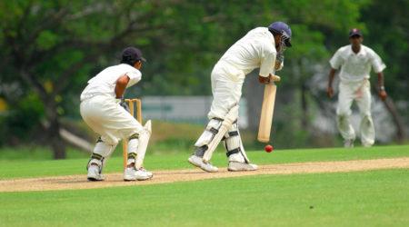 cricket batsman and a catcher