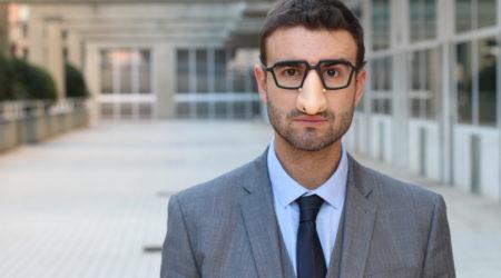 Businessman wearing fake nose-glasses combo